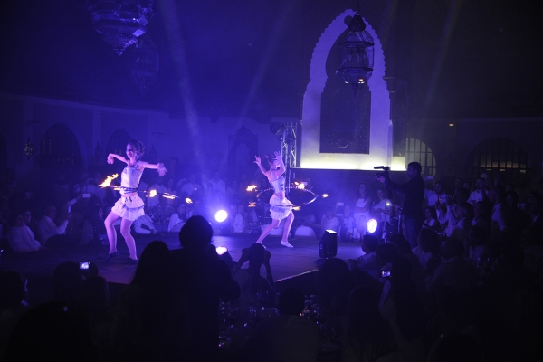 show choreography show with fire during corporate dinner abroad